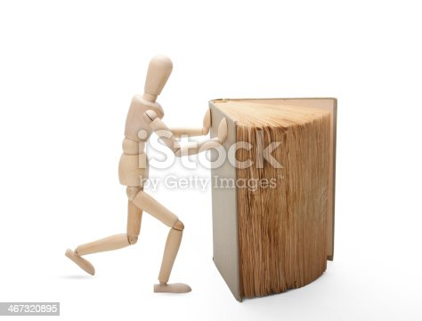 153178960istockphoto Wooden man and book 467320895