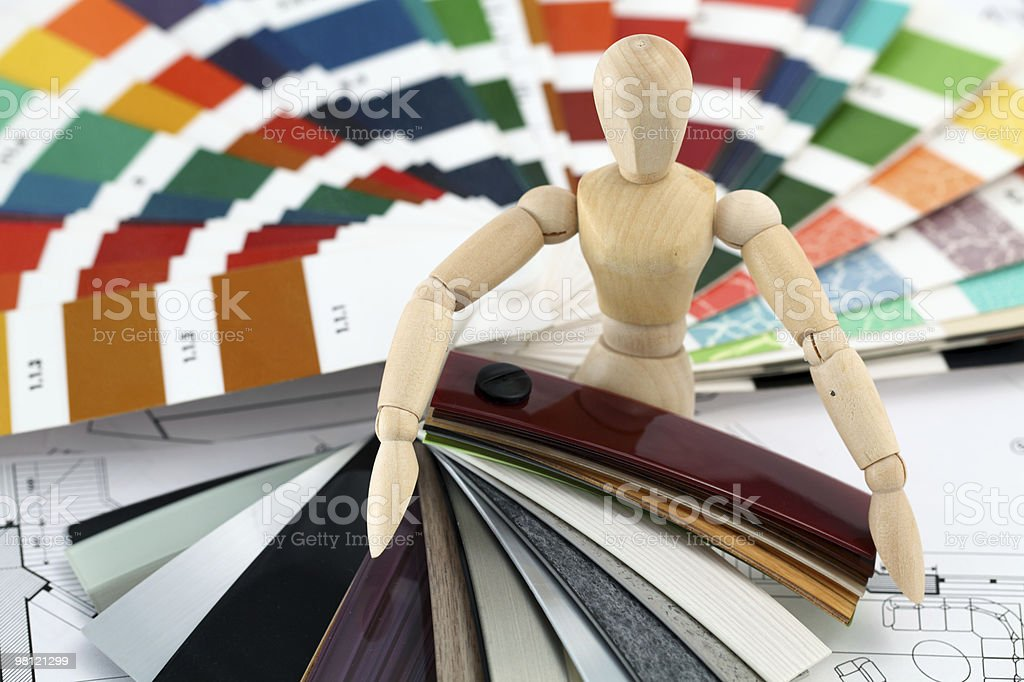 wooden man, palette, plastics & house plan royalty-free stock photo