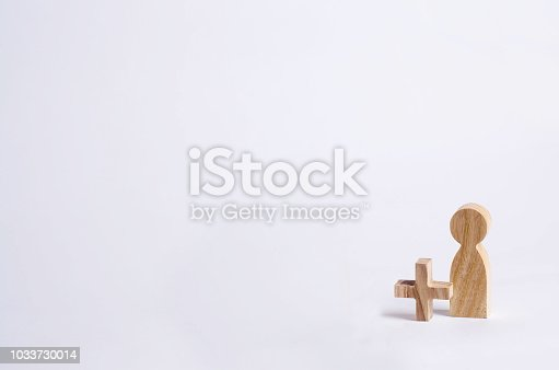 istock A wooden man with a plus. Add a person, new staff. Concept of a new person, working, friend on a white background. Social mathematics, statistics. 1033730014