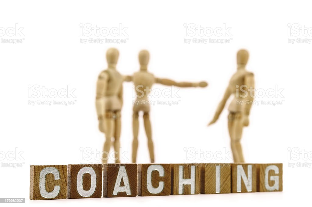 Wooden mannequin and coaching royalty-free stock photo