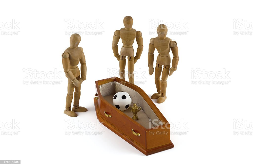 Wooden Mannequin and coffin - End of soccer cup dreams stock photo