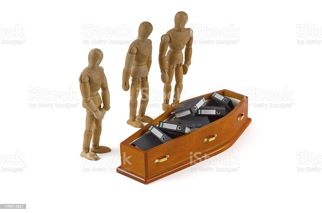 Wooden Mannequin and coffin with folders stock photo