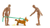 Wooden mannequin and dog poop problem - dog fouling on street with excrement or housebroken