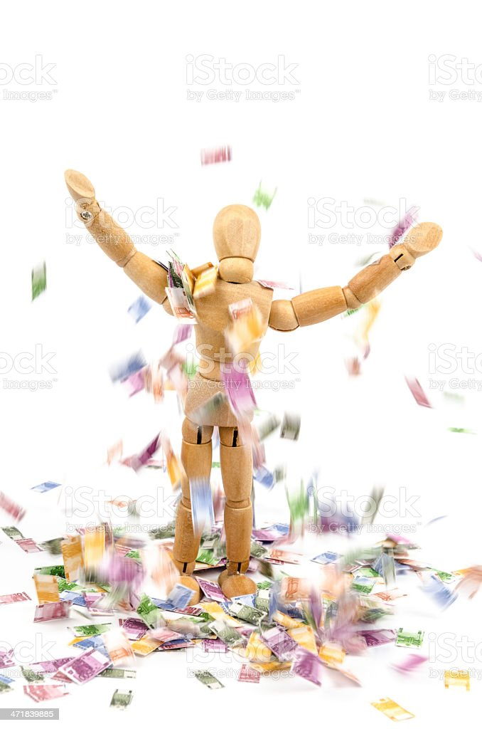 Wooden mannequin and falling euro money royalty-free stock photo
