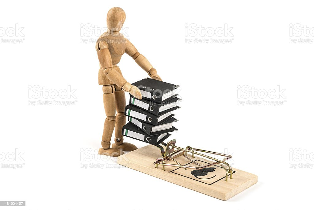 wooden mannequin and miniature folders in a mouse trap stock photo