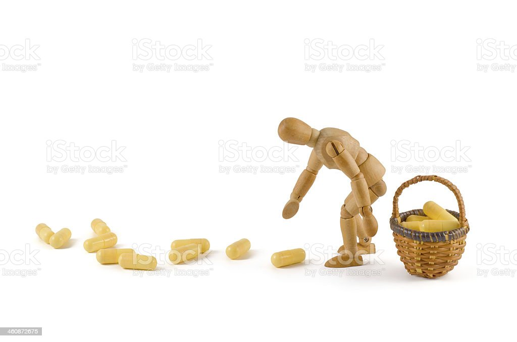 wooden mannequin and pharmaceuticals addiction stock photo