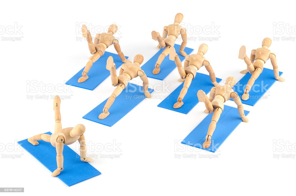 wooden mannequin and pose of yoga/ pilates in group stock photo