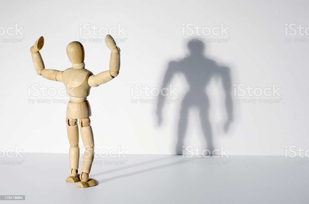 Wooden Mannequin and shadow - self-deception stock photo