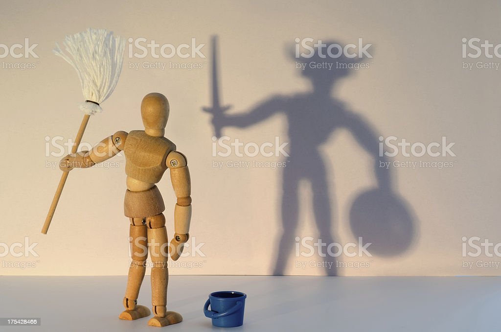 Wooden Mannequin and shadow - wrong job? stock photo