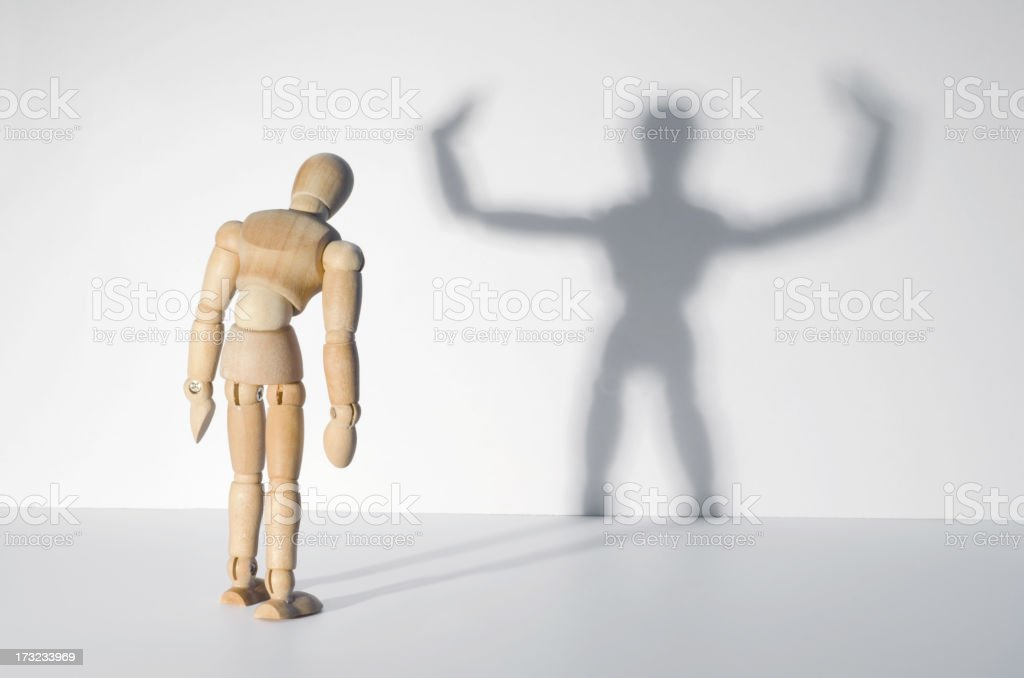 Wooden Mannequin and shadow - you are strong stock photo