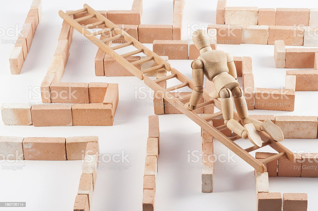 Wooden Mannequin and the shortest way through labyrinth royalty-free stock photo
