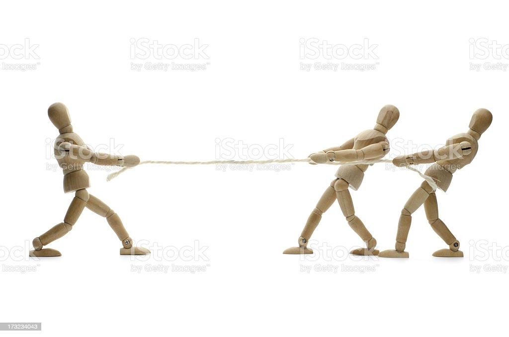 wooden mannequin and tug of war stock photo