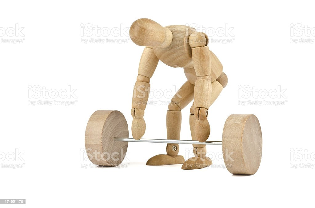 wooden mannequin and weightlifting royalty-free stock photo