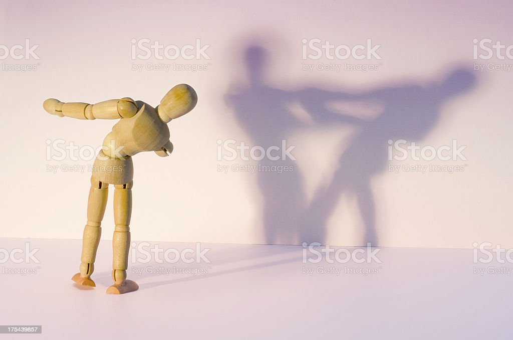 Wooden Mannequin dancing alone stock photo