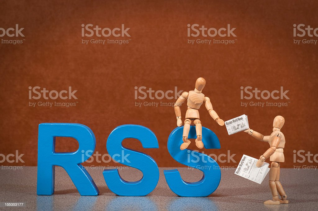 RSS - Wooden Mannequin demonstrating this word stock photo