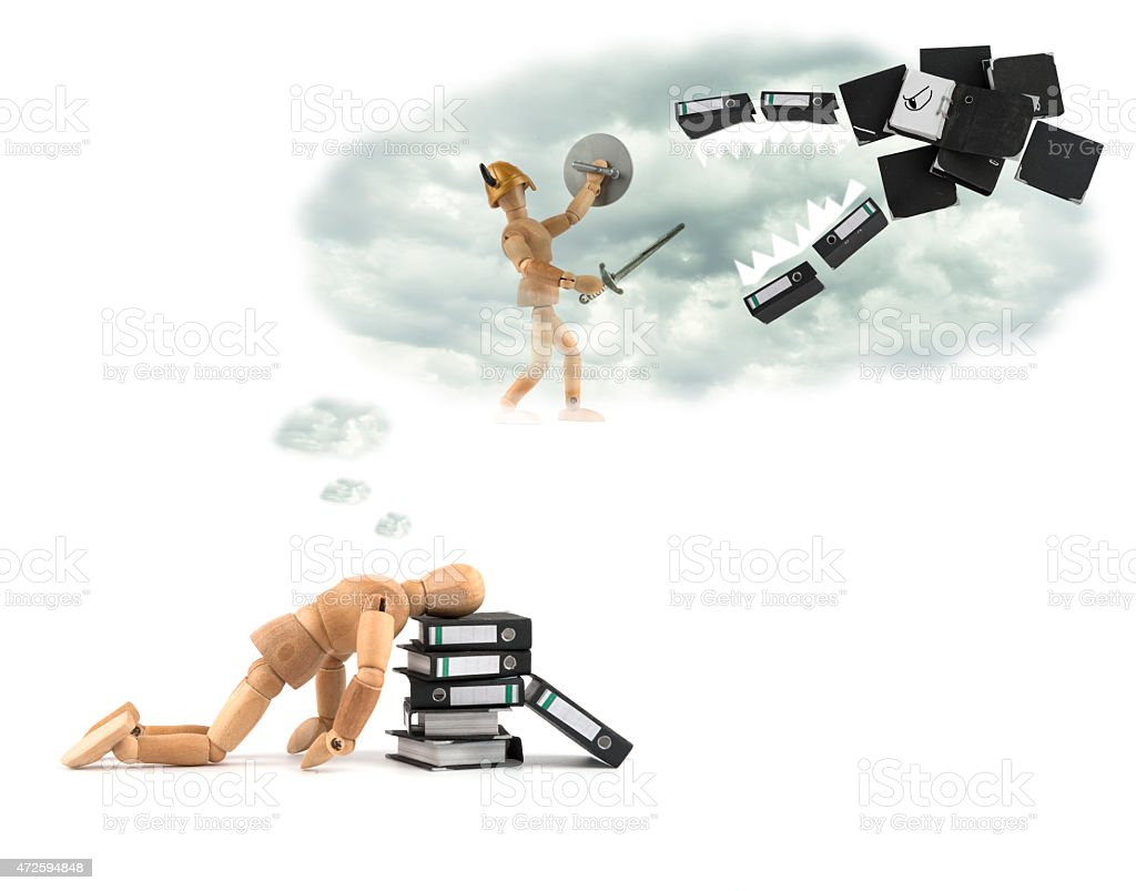 wooden mannequin dreams fighting against office folder monster - more_such_ideas_in_my_Portfolio stock photo