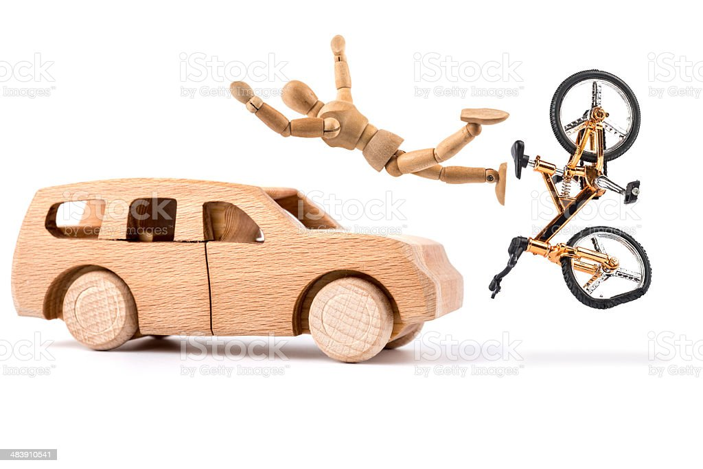 wooden mannequin falling from bicyle with accident stock photo