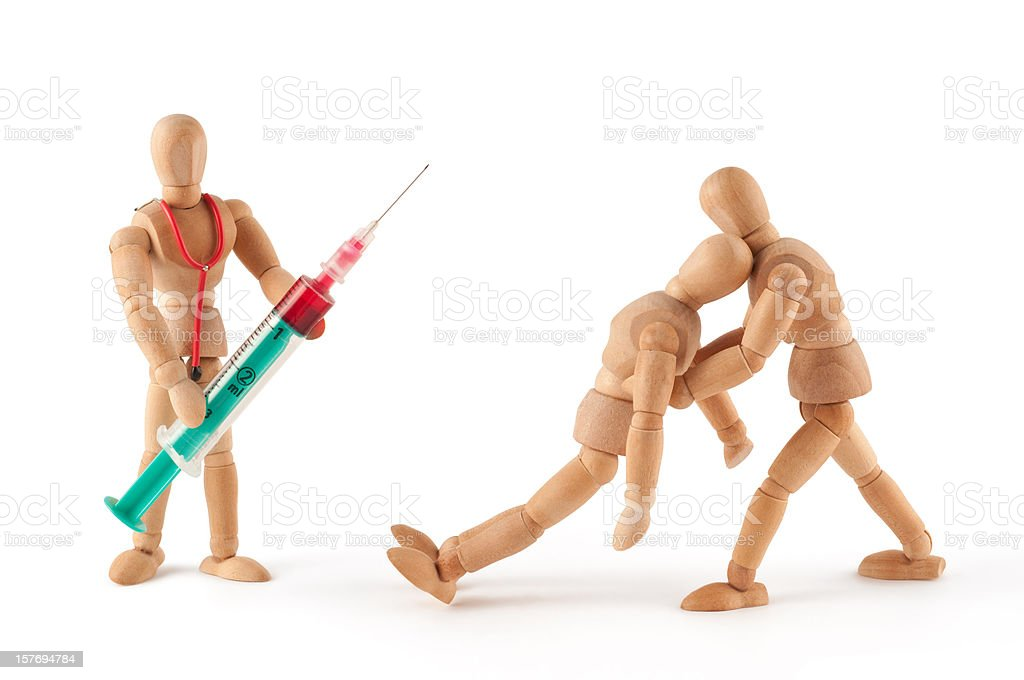wooden mannequin gets a blackout at the doctor stock photo