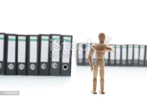 istock wooden mannequin in folders 175000634