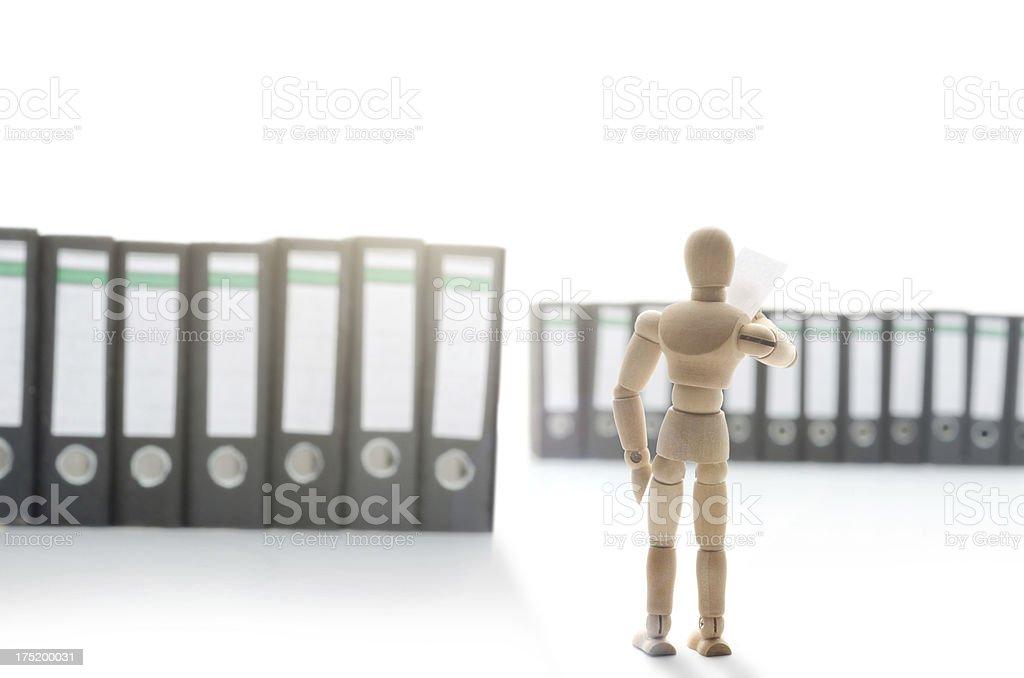 wooden mannequin in folders stock photo