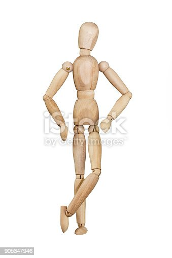 Wooden mannequin trying to represent human movements in moving actions isolated on a white background. Anatomical model with hands on hips and crossed legs.