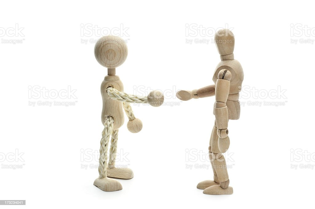 Wooden Mannequin meeting an enemy man stock photo