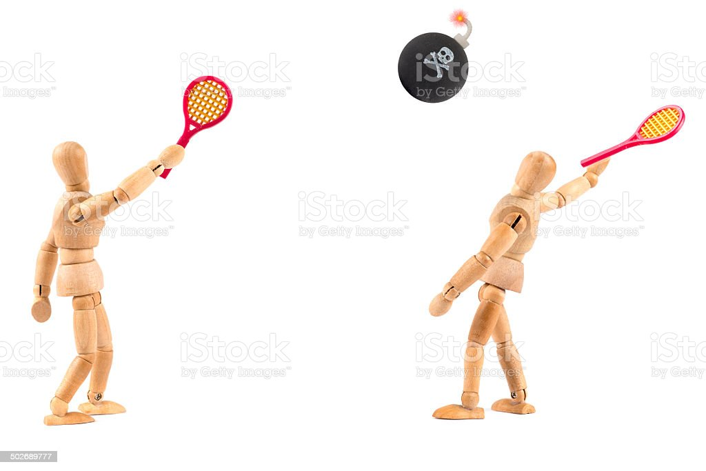 Wooden Mannequin playing tennis with a bomb stock photo