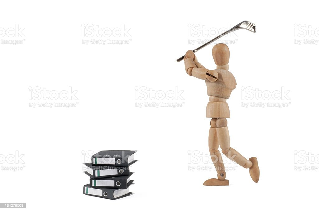 Wooden Mannequin plays golf with folders stock photo