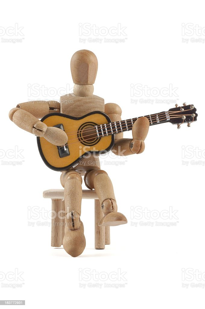 wooden mannequin plays guitar royalty-free stock photo