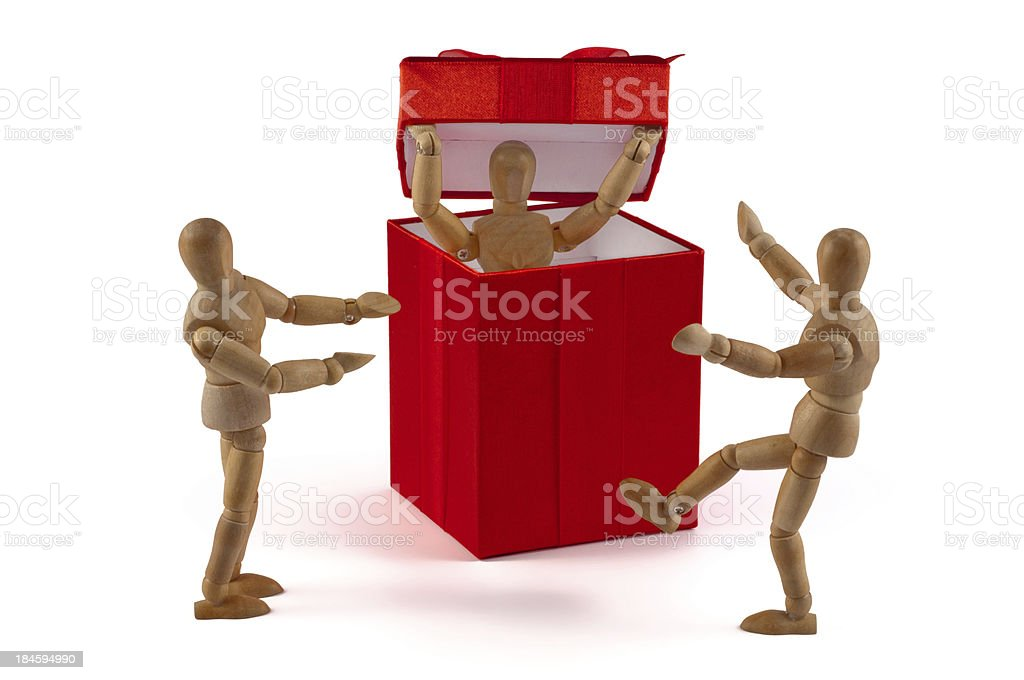 Wooden mannequin presents a huge gift royalty-free stock photo