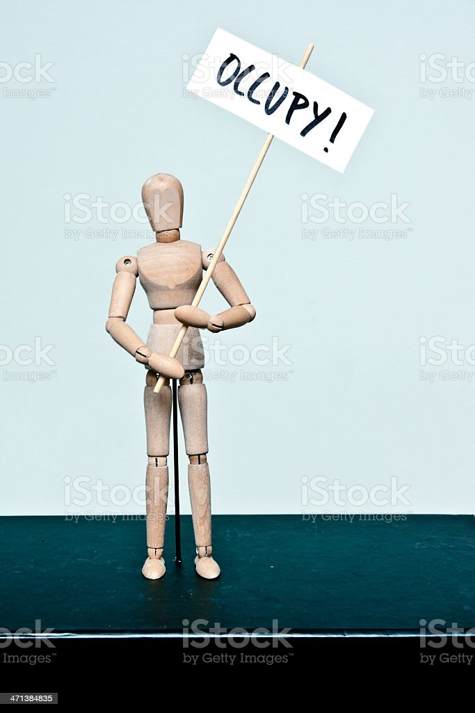 wooden mannequin: protester 'occupy' royalty-free stock photo