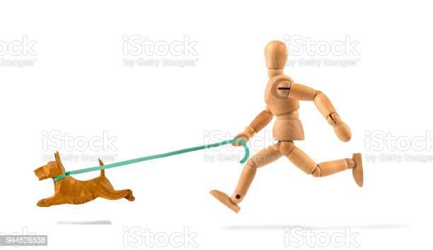 Wooden mannequin running with dog for sport picture id944526538?b=1&k=6&m=944526538&s=612x612&h= b4wggcnaoksadlykkzcgomihlnhzrwl y31cb1hszg=