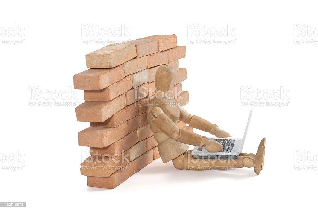 wooden mannequin save behind firewall royalty-free stock photo
