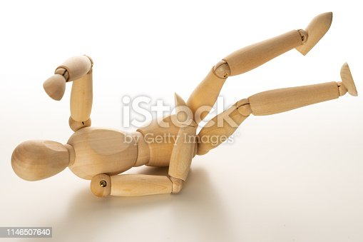 Wooden mannequin slip and fall down. Health care concept.