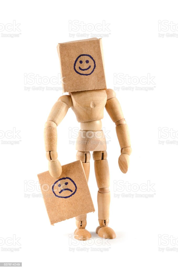Wooden mannequin - smiling or sad? stock photo