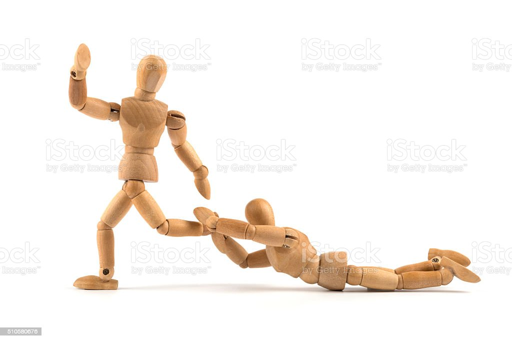 wooden mannequin tries to hold back the one going on stock photo