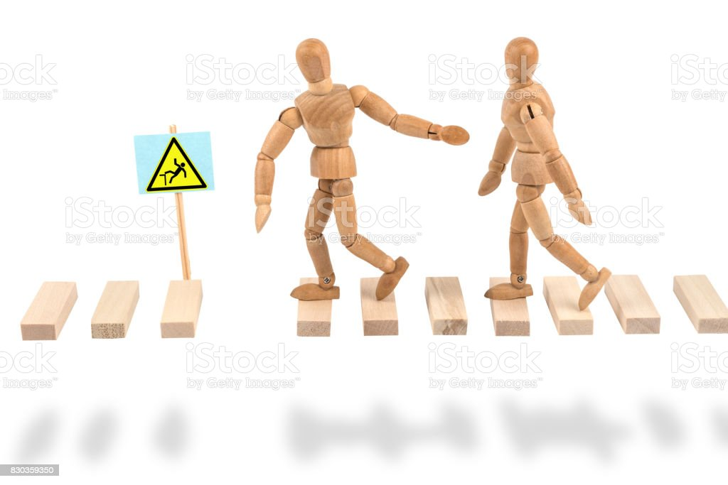 Wooden mannequin with attention deficit for danger stock photo