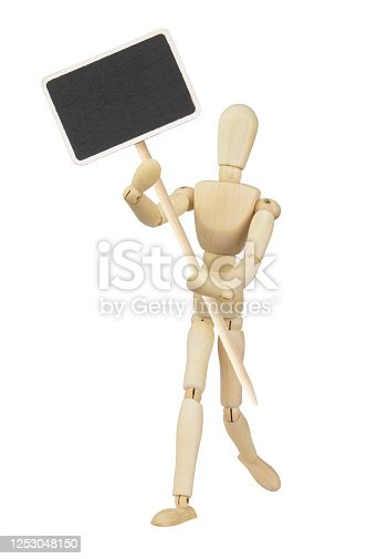 923869178 istock photo Wooden mannequin with chalkboard banner isolated 1253048150