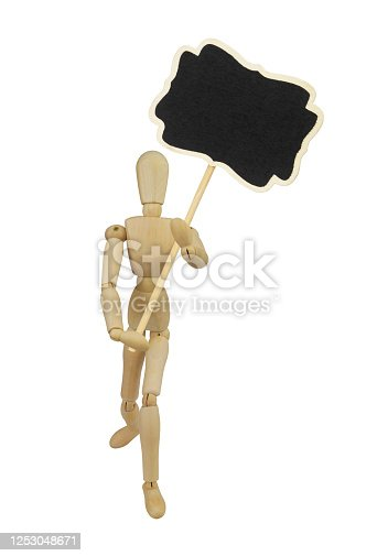 923869178 istock photo Wooden mannequin with chalkboard banner isolated 1253048671