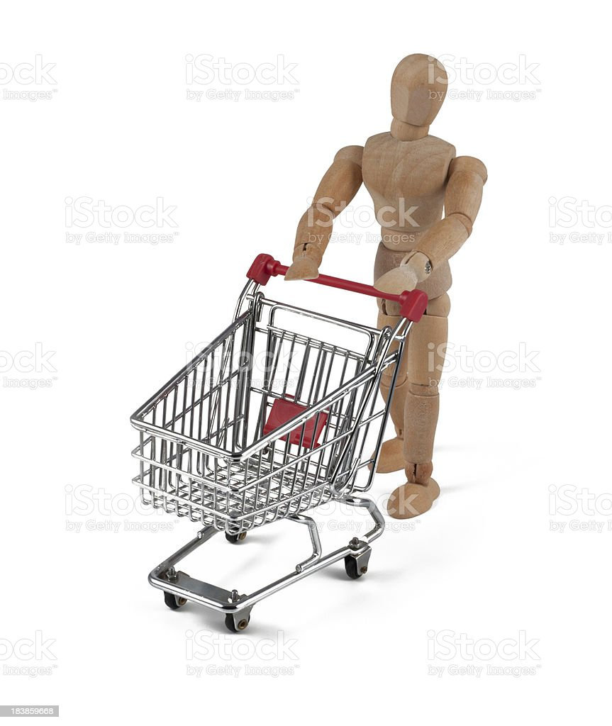 wooden mannequin with shopping cart royalty-free stock photo