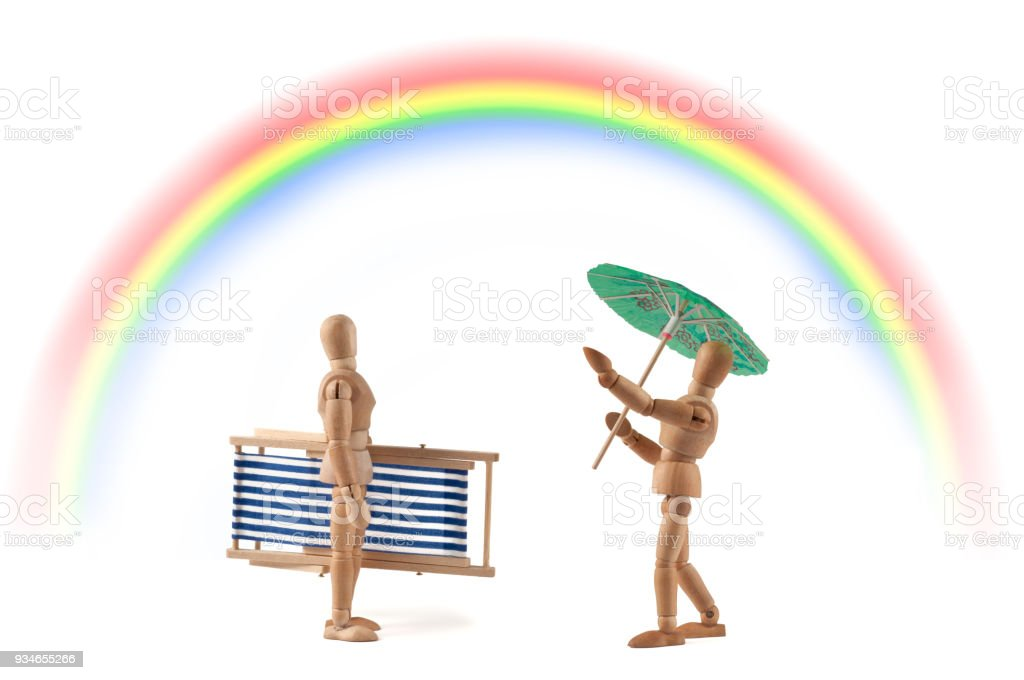 Wooden mannequin with weather problems - rainbow - rain or sunshine? stock photo