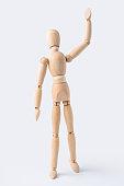 istock wooden mannequin with welcome gesture 1089708262