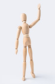 istock wooden mannequin with welcome gesture 1089708262
