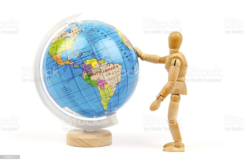 wooden mannequins and globe world stock photo
