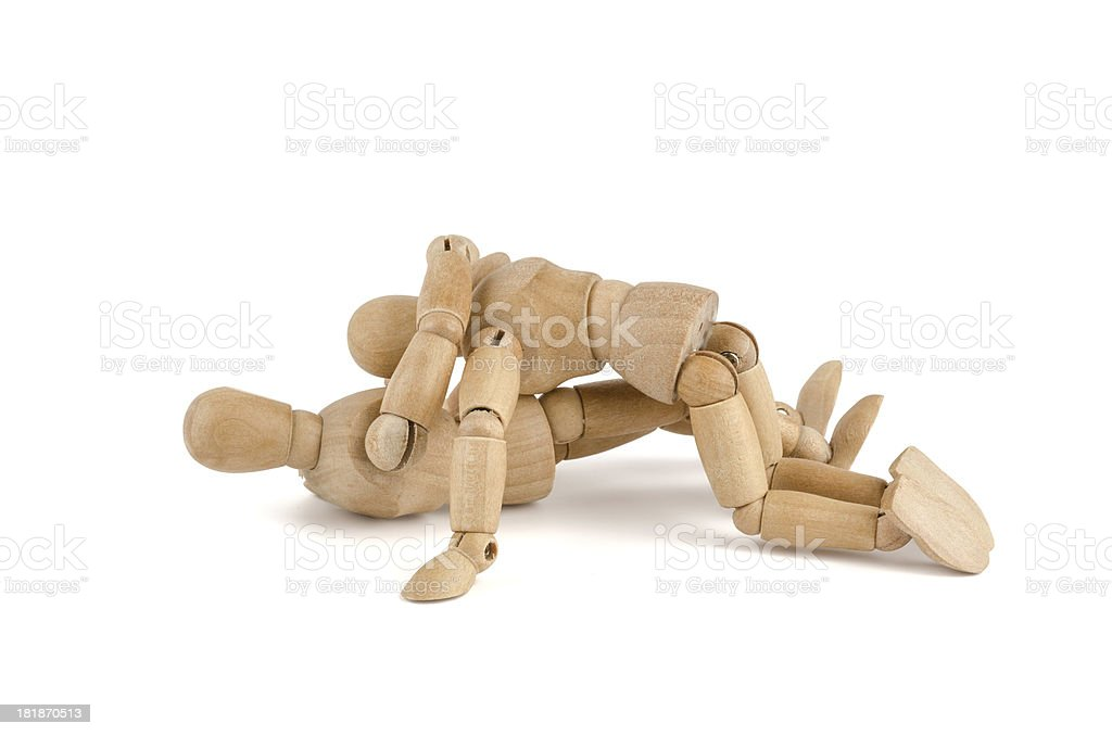 wooden mannequins fighting on bottom royalty-free stock photo
