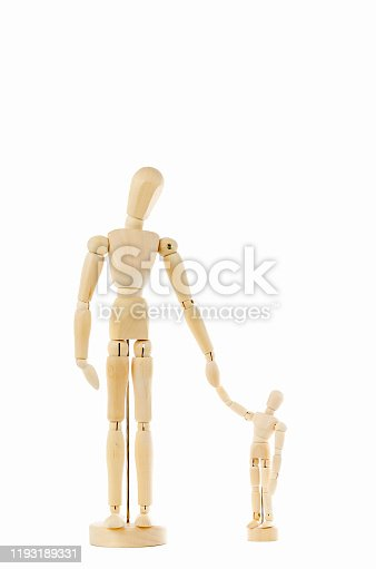 Wooden mannequins figures doll father and son  isolated on white background