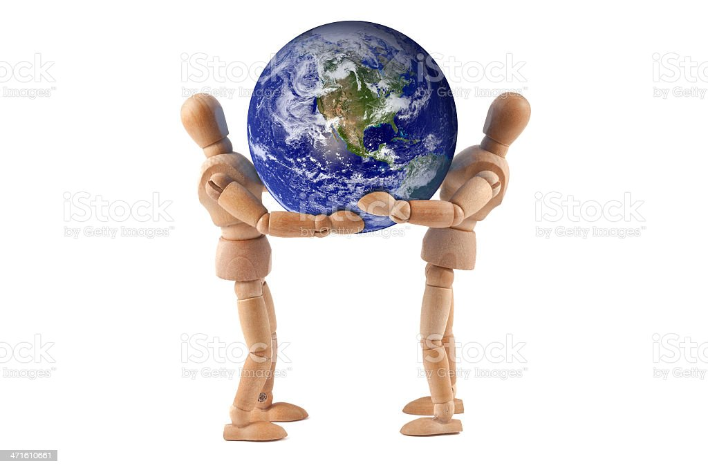wooden mannequins holding the world stock photo