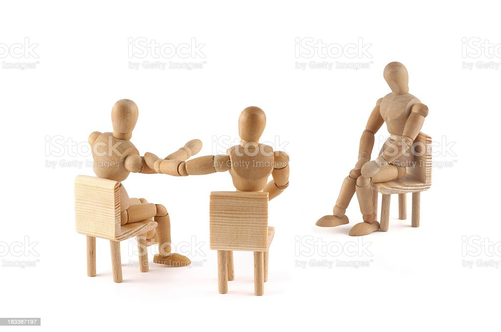 wooden mannequins in discussion stock photo