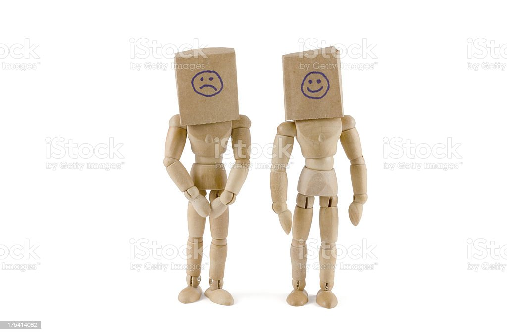 Wooden mannequins - smiling or sad? stock photo
