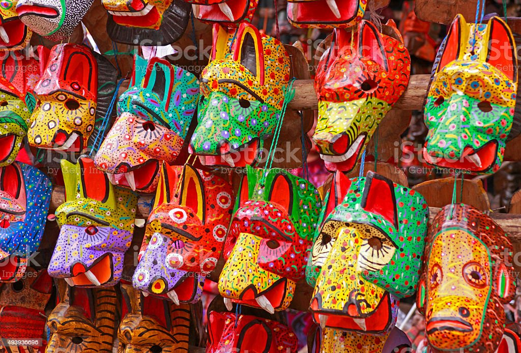 Wooden masks Wooden masks at the market in Chichicastenango, Guatemala. 2015 Stock Photo